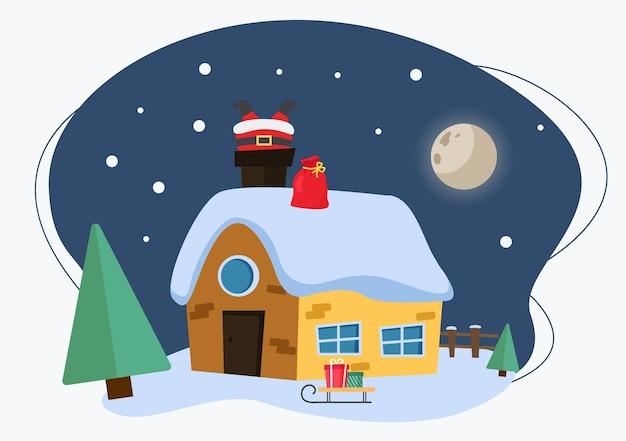 Зимний коттеджный домик со снегом. дед мороз застрял в дымоходе на крыше.