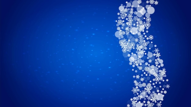 Winter frame with falling snow on blue background with sparkles.