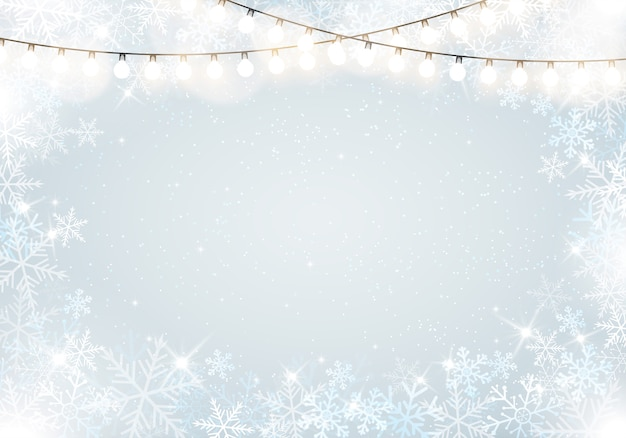 Winter frame with snowflakes and hanging fairy lights