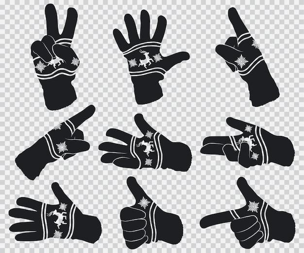 トナカイと雪片の冬の手袋。透明な背景に分離された手ジェスチャー黒シルエットセット。