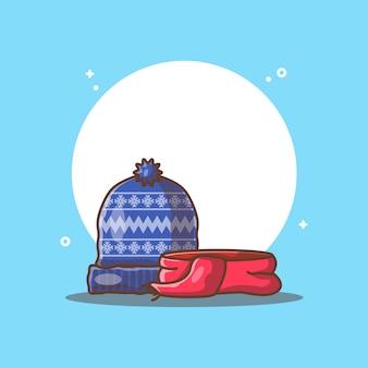 Зимняя шапка и шарф, изолированные на синем