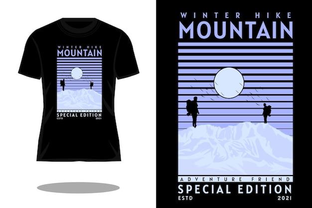冬のハイキング山のシルエットレトロなtシャツのデザイン