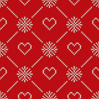 Зимний праздник вязаный узор с сердечками и снежинками. день святого валентина бесшовный фон