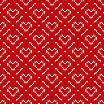 Winter holiday knitted pattern with hearts. valentine's day seamless background