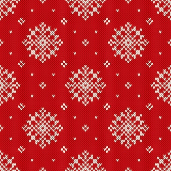 Winter holiday knitted pattern with snowflakes.  seamless knitting background