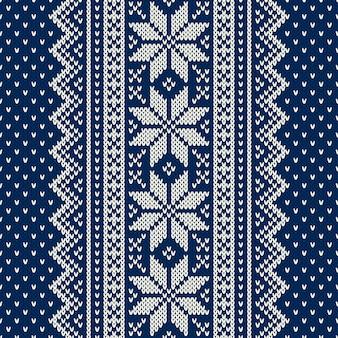 눈송이와 겨울 휴가 원활한 니트 패턴입니다. 크리스마스와 새 해 디자인 배경입니다. 전통적인 뜨개질 스웨터 디자인