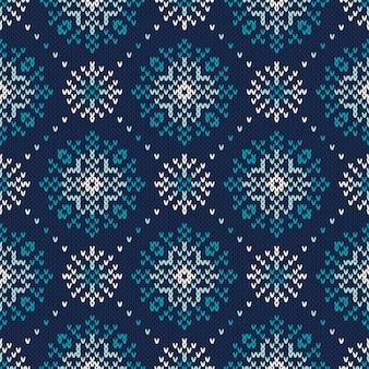 冬の休日のシームレスな編み物パターン。ウールニットテクスチャの模倣