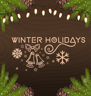 Winter holidays card. christmas design with spruce branches and electric garland on a wooden background.
