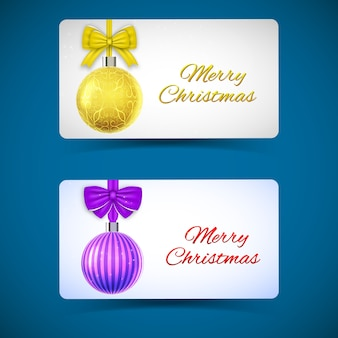 Winter holidays horizontal cards with hanging yellow purple ornate christmas baubles and ribbon bows