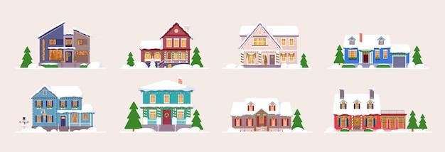 겨울 집. 눈 덮힌 장식 건물 세트. 집 외관 디자인입니다.