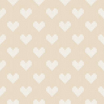 Winter knitted pattern with hearts. valentine's day seamless background