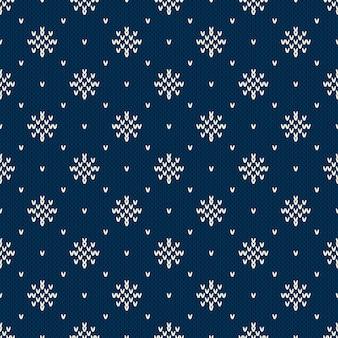 Зимний вязаный узор со снежинками. дизайн вязанного свитера fair isle. бесшовные рождество и новый год фон