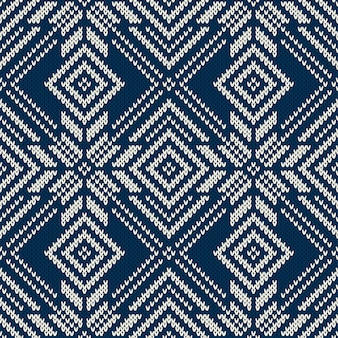 Winter knitted pattern with snowflakes. seamless background