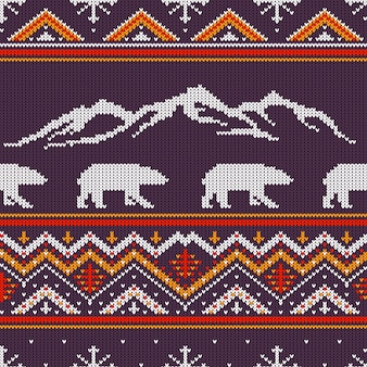 Winter knitted woolen pattern with polar bears and snow-capped mountains