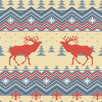 Winter knitted woolen seamless pattern with red deers