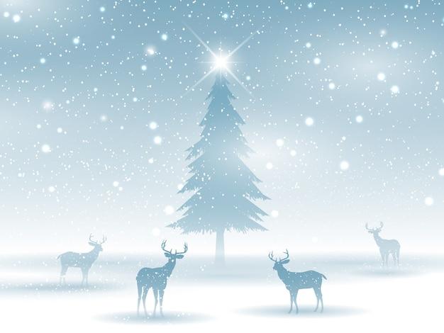 鹿のシルエットの冬の風景
