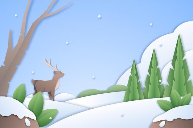 紙のスタイルで雪とトナカイと冬の風景