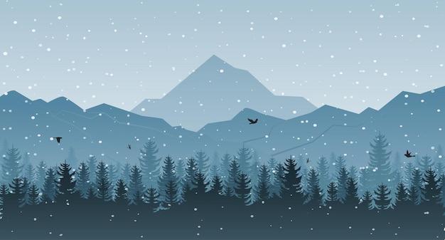 木と山のある冬の風景