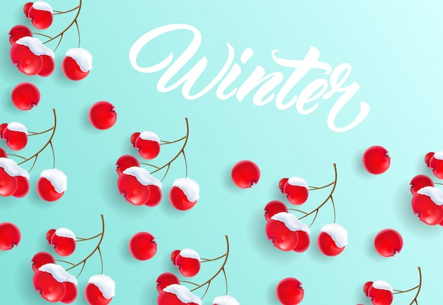 Winter lettering on background with rowan berries pattern Free Vector