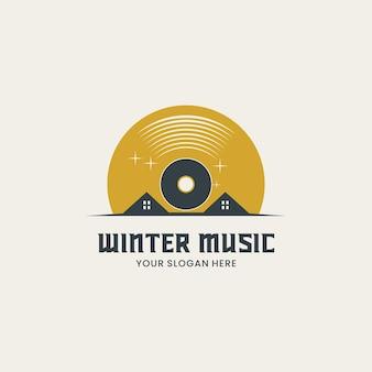 冬の音楽のロゴ、ディスクのある家