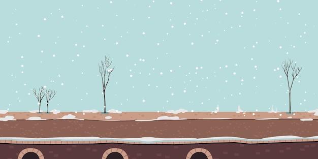 冬の川の遊歩道または雪と橋