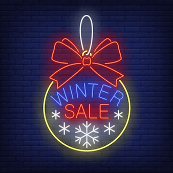 Winter sale banner, christmas ball in neon style