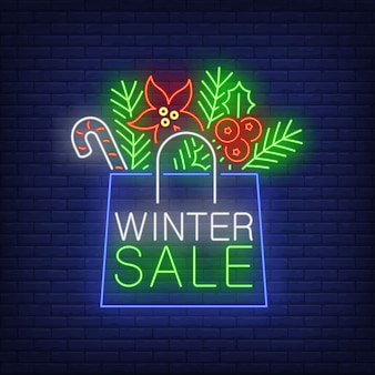 Winter sale banner, paper bag in neon style