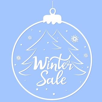 Зимняя распродажа ручной надписи. елочный шар. баннер для новогодней скидки.