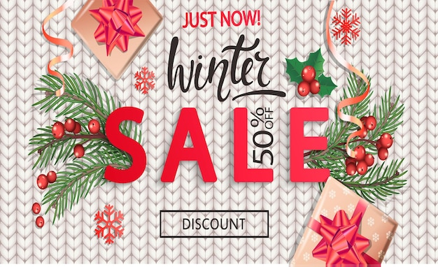 Winter sale knitted banner for christmas and new year holidays.50 percent discount card on white background with traditional christmas elements-gift box with gold bow,candy cane, branch.vector.