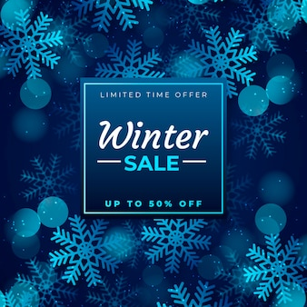 Winter sale promo with blurred snowflakes