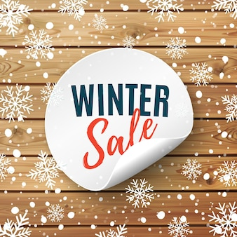 Winter sale round banner. price tag on wooden background with snow and snowflakes. promotion badge. vector illustration.