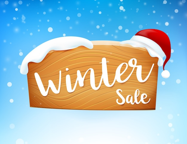 Winter sale on wooden sign and snow fall