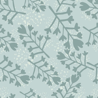Winter seamless pattern in blue colors. flowers and branches silhouettes with splashes.