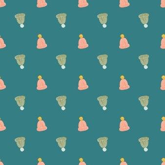 Зимний бесшовный образец с маленькими силуэтами шерстяной уютной шляпы. бирюзовый фон. графический дизайн оберточной бумаги и текстуры ткани.