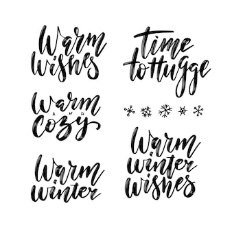 Winter season and christmas greetings lettering set. time to hugge, warm and cozy, warm winter, warm winter wishes brush calligraphy
