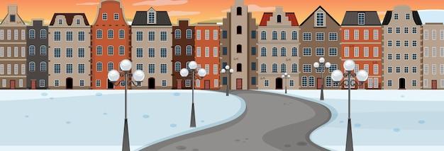 Зимний сезон с дорогой через парк в город во время заката горизонтальная сцена