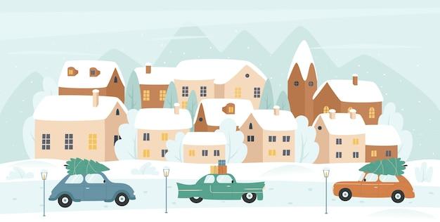 かわいい家とヴィンテージカーのある冬の小さな街