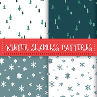 Winter trees and snowflakes seamless patterns