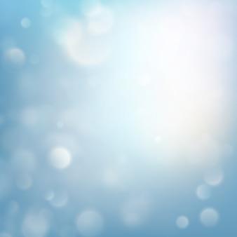 冬のクリスマスクリスマスのテーマ。青いキラキラ背景のボケ味。