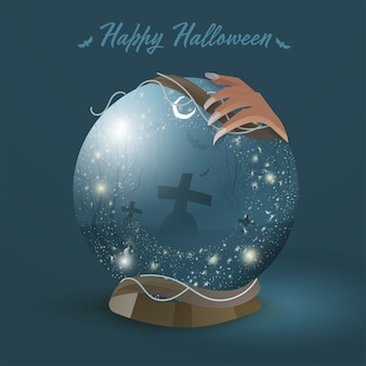 Witch hand holding magic ball with graveyard night scene on teal blue background for happy halloween celebration.