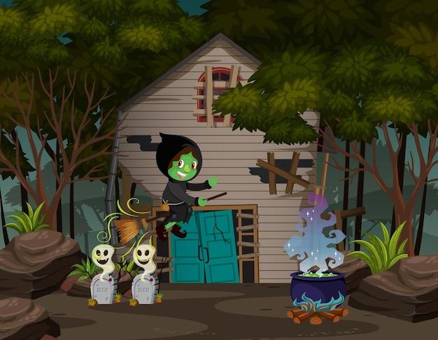 森の中のお化け屋敷の前でほうきに乗る魔女