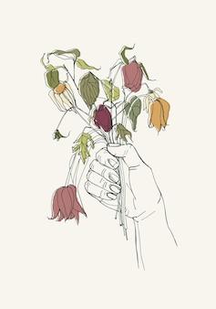 Увядшие цветы в руке, ушедшее чувство концепции