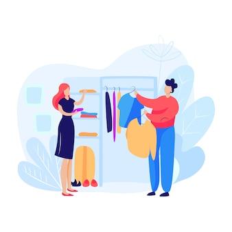 Женщина и мужчина, выбирая одежду