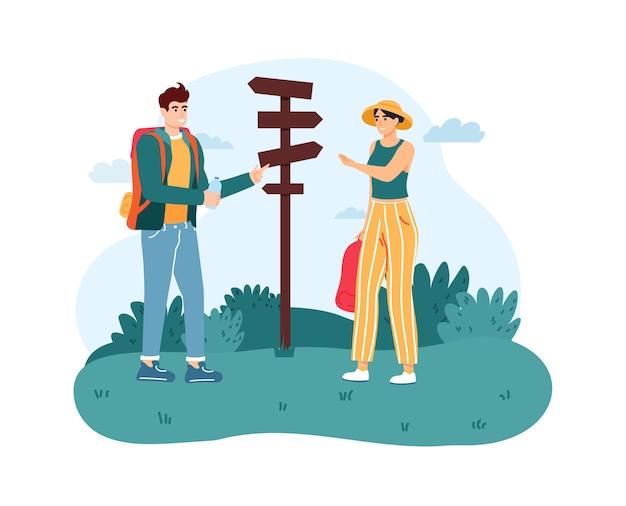 방향 기호 또는 포인터 근처에 서있는 여자와 남자 등산객. 프리미엄 벡터
