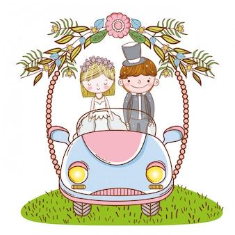 Женщина и мужчина свадьба в машине с цветами растений Premium векторы