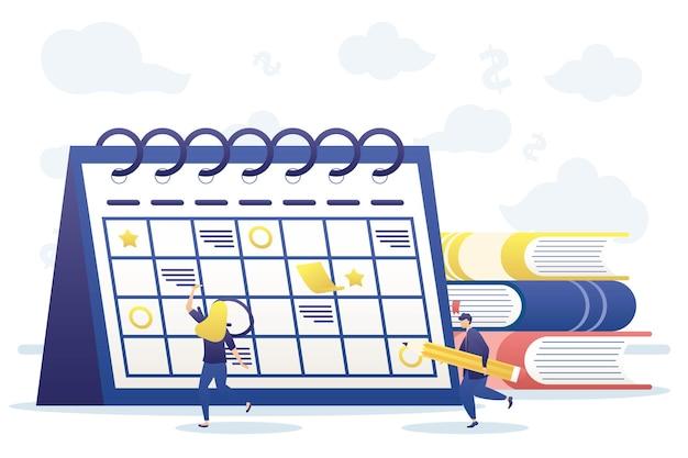 Женщина и мужчина с календарным планированием