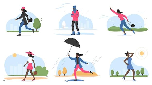 Женщина и погода четырех сезонов устанавливают женский персонаж зимой, осенью, весной, летом