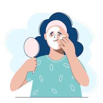Woman applying cosmetic mask on face.
