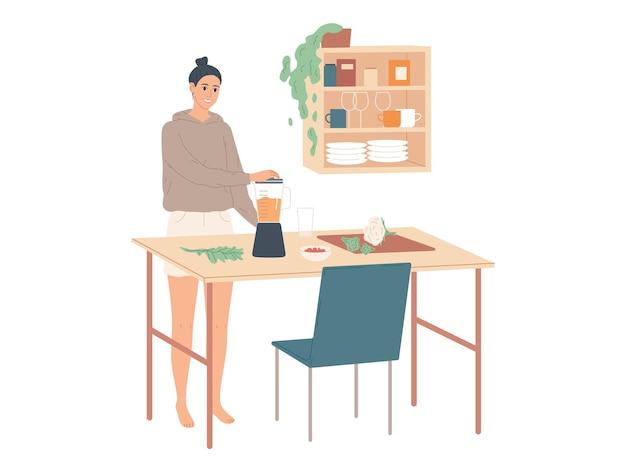 부엌에서 집에서 여자는 믹서기를 사용하여 음식을 요리합니다.