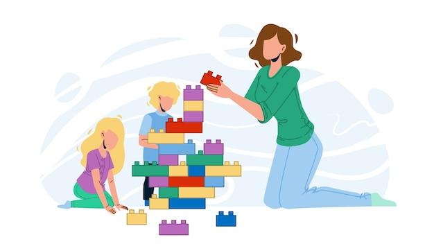 女性のベビーシッターと子供たちと遊ぶ
